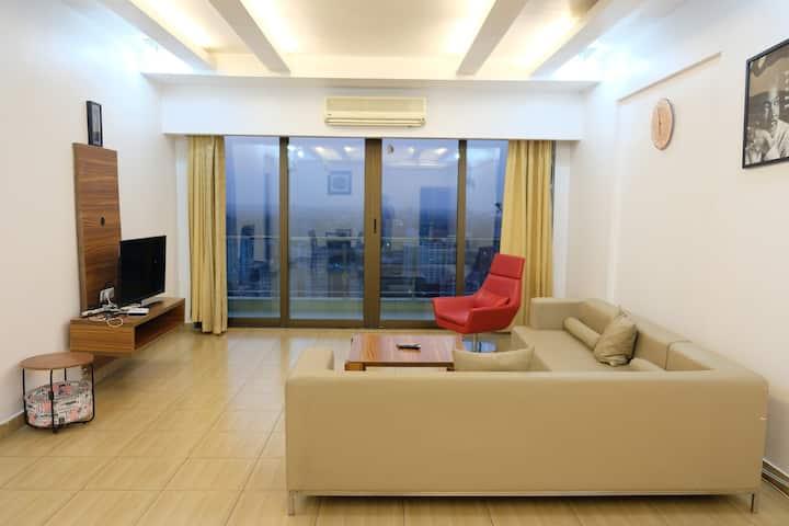 A wide room facing City lights