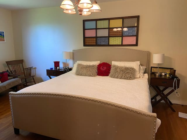 The master bedroom features a king-sized bed with a luxurious memory foam mattress. It also has a fold out futon for more folks.