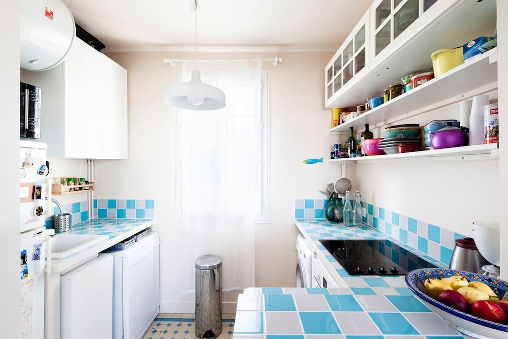 Open plan kitchen with dishwasher, washing machine, fridge, freezer, oven, microwave
