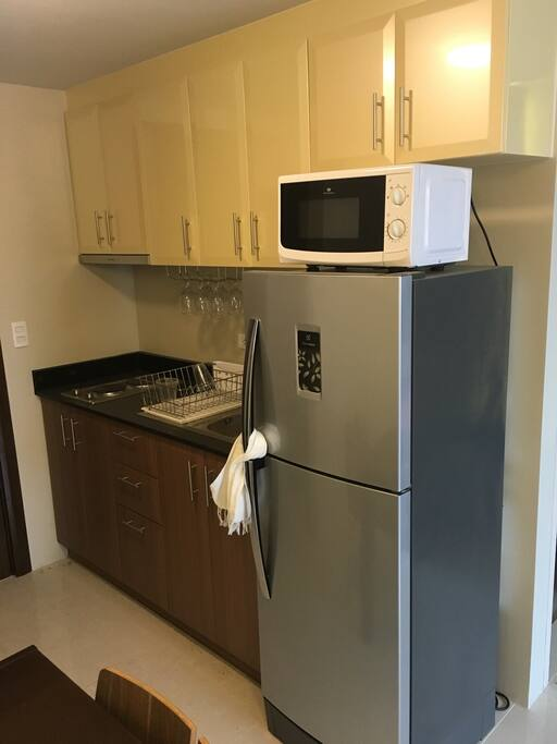 7.5 cu.ft chiller/freezer, 2 hub electric stove w/ exhaust hood, kitchenette, coffee maker, oven toaster, microwave, chinaware, cutleries & cooking utensils