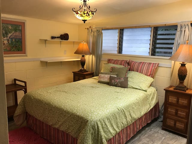 """Private bedroom with a locking door. Very comfortable Queen-size bed. Large closet to hang clothes. Plenty of linens. TV & board games to """"play""""!"""