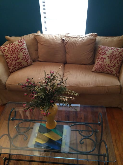 Couch in living room does NOT pull out but is very COMFY to sleep on