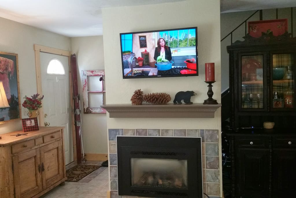 Gas Fireplace, Flat screen TV and rear door to deck