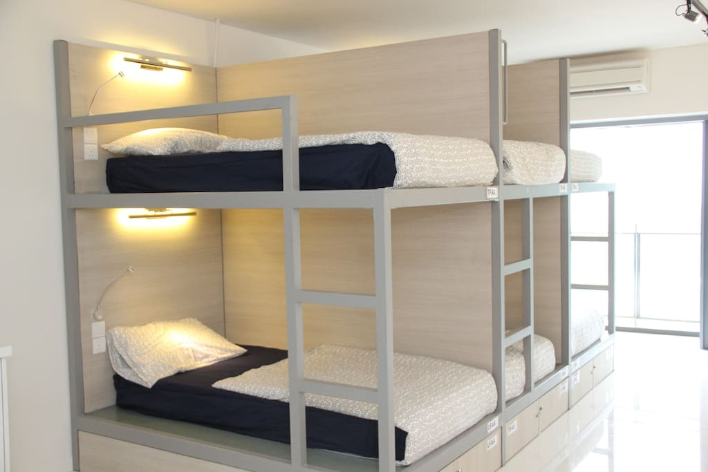 Custom made modern bunk beds with private storage space
