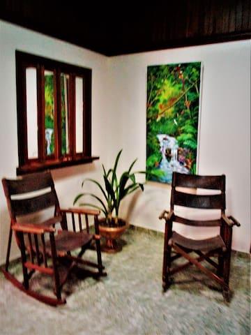 Custom hardwood furnishings throughout.
