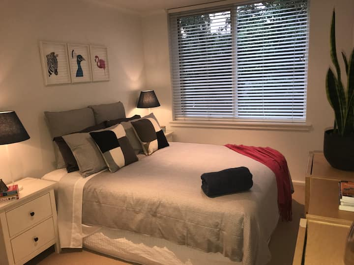 Immaculate bedroom in tasteful St Kilda apartment.