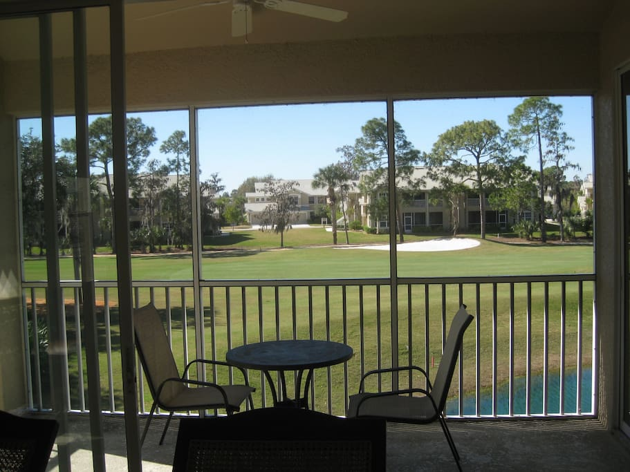 This is your view from your living room,past the lanai to the lake and golf course