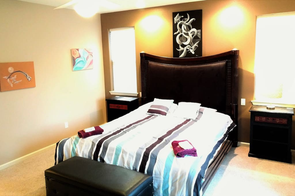 Master Bedroom has a California King Size bed and its own private bathroom and walk-in closet. Also, direct access to the backyard. No desk inside room though. Occupancy capacity for room is 4 guests. Airbed set up when 3 or more guests book.