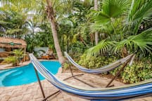 Relax and take a nap in the poolside hammocks
