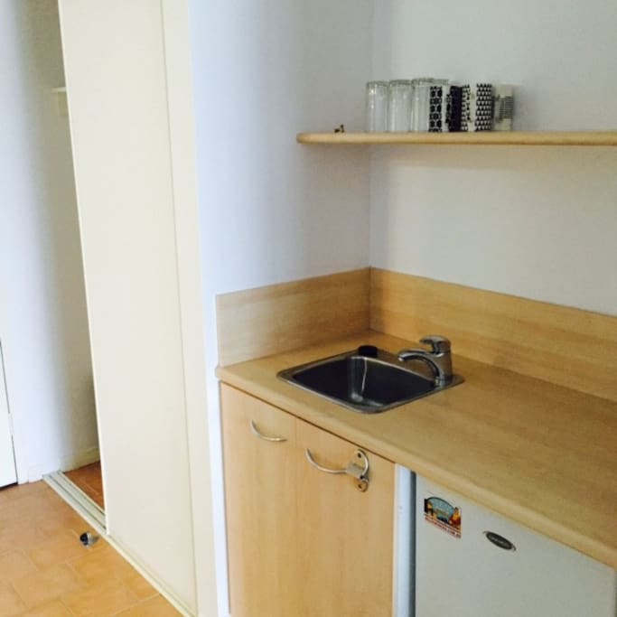 Kitchenette includes microwave, kettle, fridge and robe
