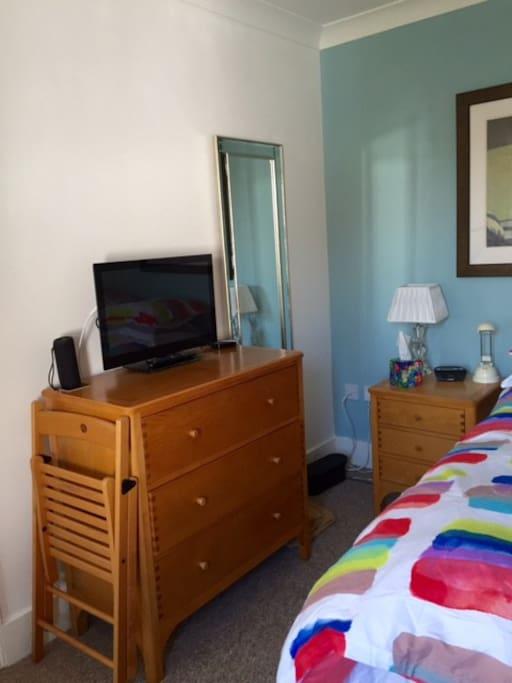 Smart tv, dressing table, bedside locker, digital radio clock