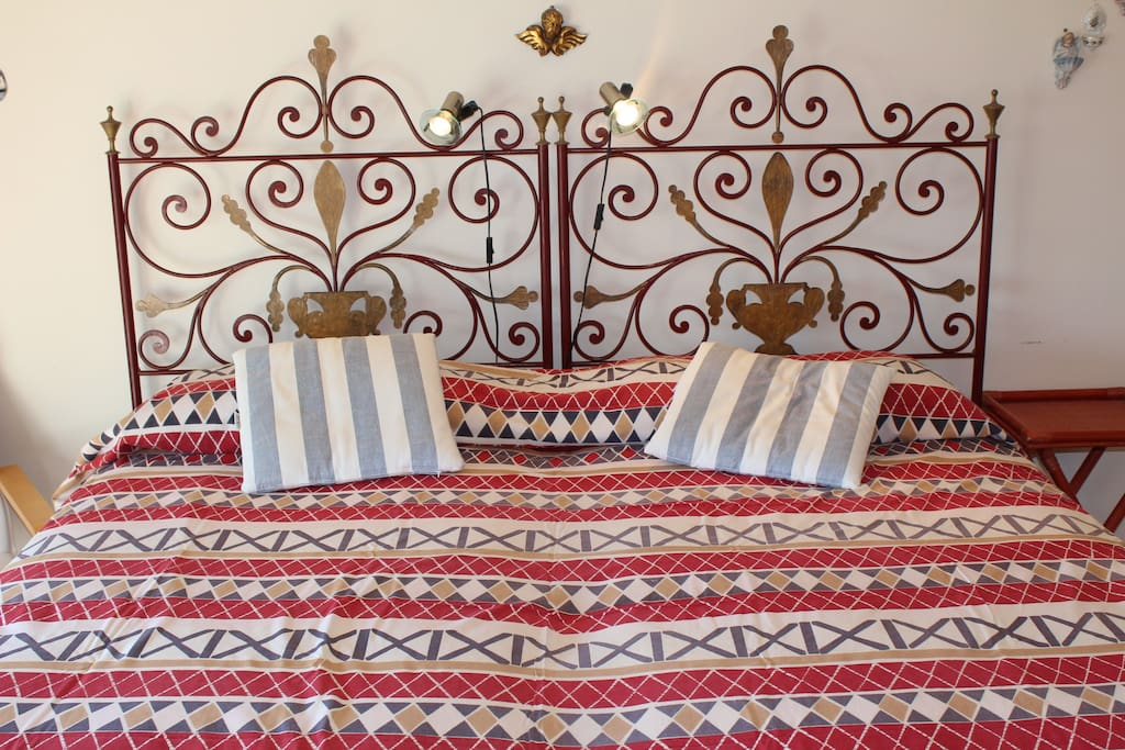Bedroom 1 – Beautiful ornate iron bed, Queen size
