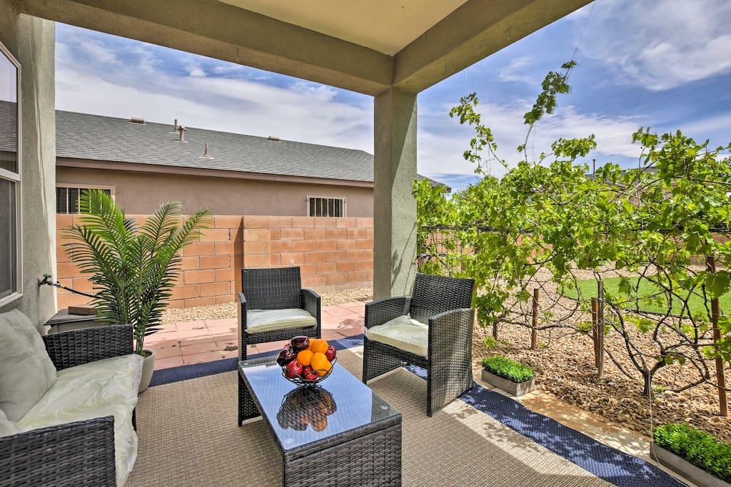 With a shaded patio and beautiful backyard, this property is an outdoor oasis!