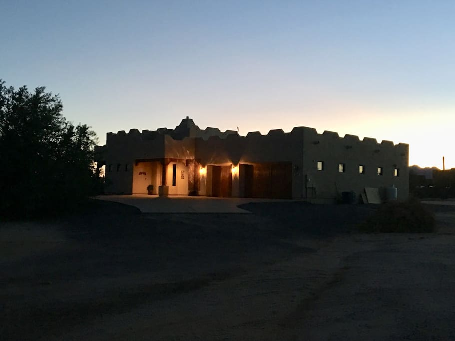 View of the front of the house at dusk.