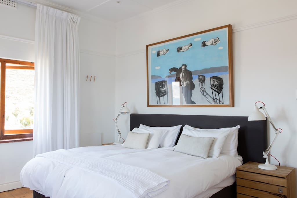 A sunny and natural light filled deluxe room