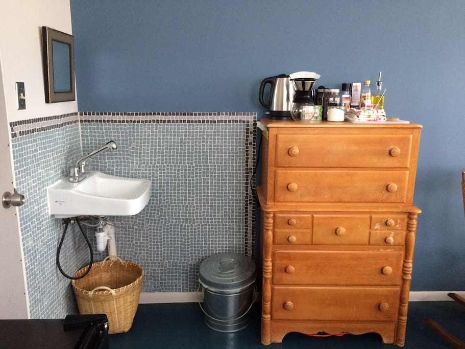 There is a convenient sink and separate restroom for guests only, and plenty of bookshelf and dresser space for organizing your things.