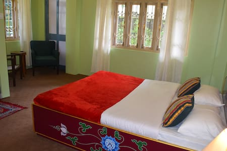 The room. All the beds have been hand painted by a third generation 'thangka' painter - a small slice of Sikkimese Art and Culture in all our rooms