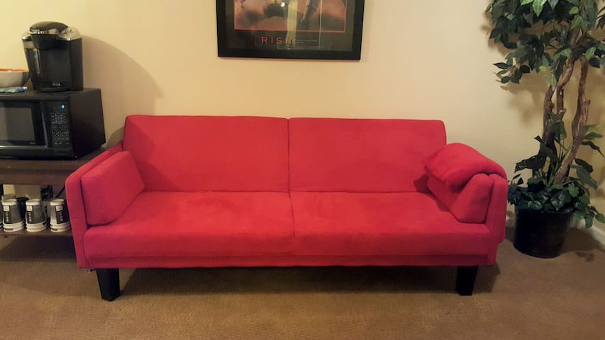 Brand new stylish futon! Perfect for your travel companion and more convenient than an air mattress