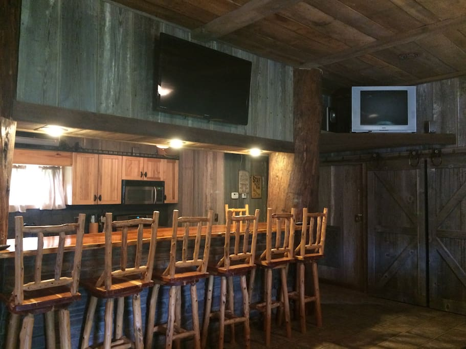 Bar with seating and TVs