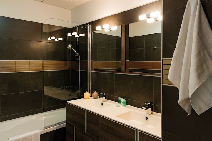 The clean bathroom will have a shower or a bathtub! There is an extra shower with this apartment.