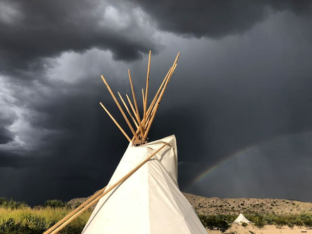 The smoke flaps can be closed up to keep you cozy and dry in your tipi during the rare desert storms.