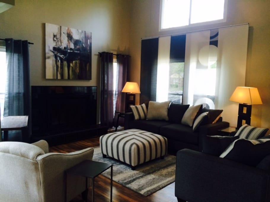 Living area high ceilings & windows