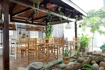 There are two spacious dining huts in front of the Villa Ali 5B