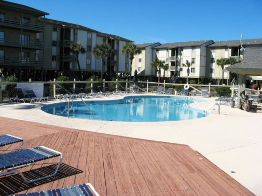 Enjoy spectacular views of the Savannah River entrance & Atlantic Ocean with dolphin, bird & ship watching, 2 full size pools, & a Kiddies` Pool