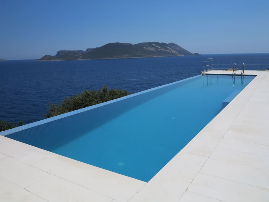 Rim pool over looking islands and olive grove