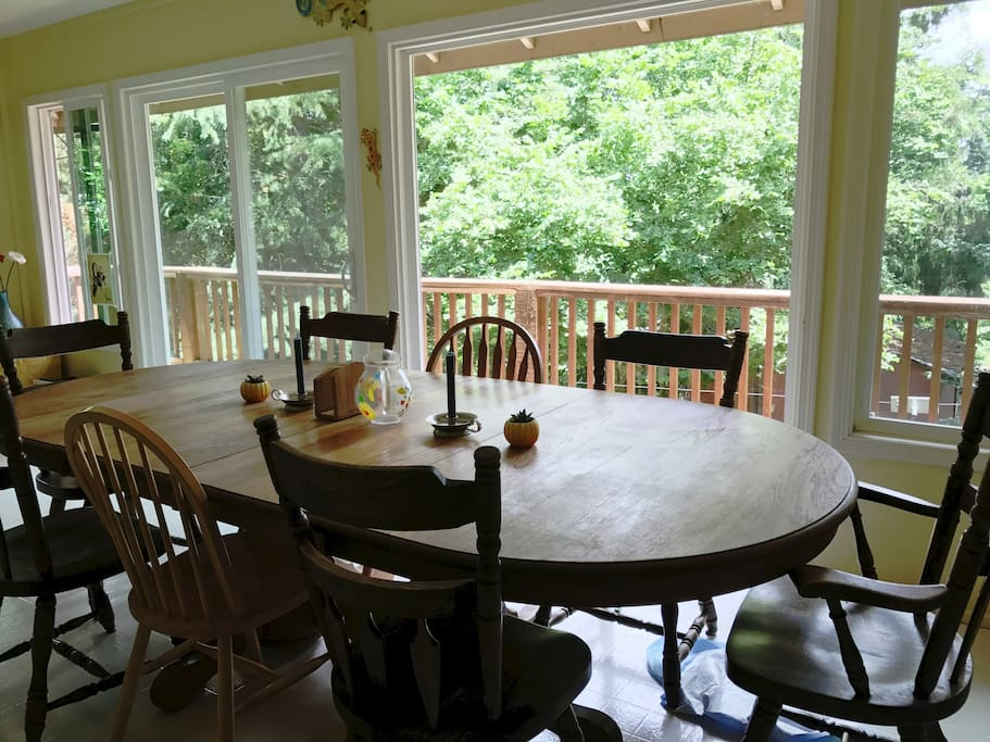 The dining area is an enclosed porch with seating available for 16 and floor to ceiling picture windows.
