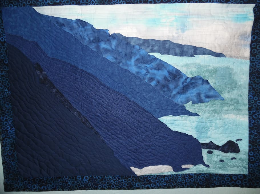 """Big Sur"", one of many custom quilts in the home"
