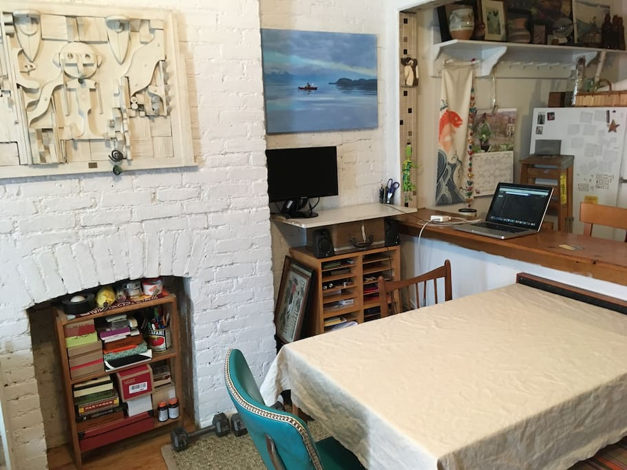 Exposed brick, DIY standing desk and table.
