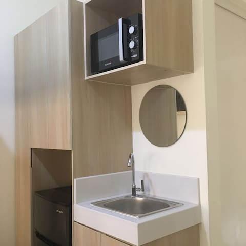 Clean water from the sink, microwave oven for heating your food, a refrigerator and a mirror to see your beautiful face!