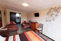 Roots Guest Lodge - Family room