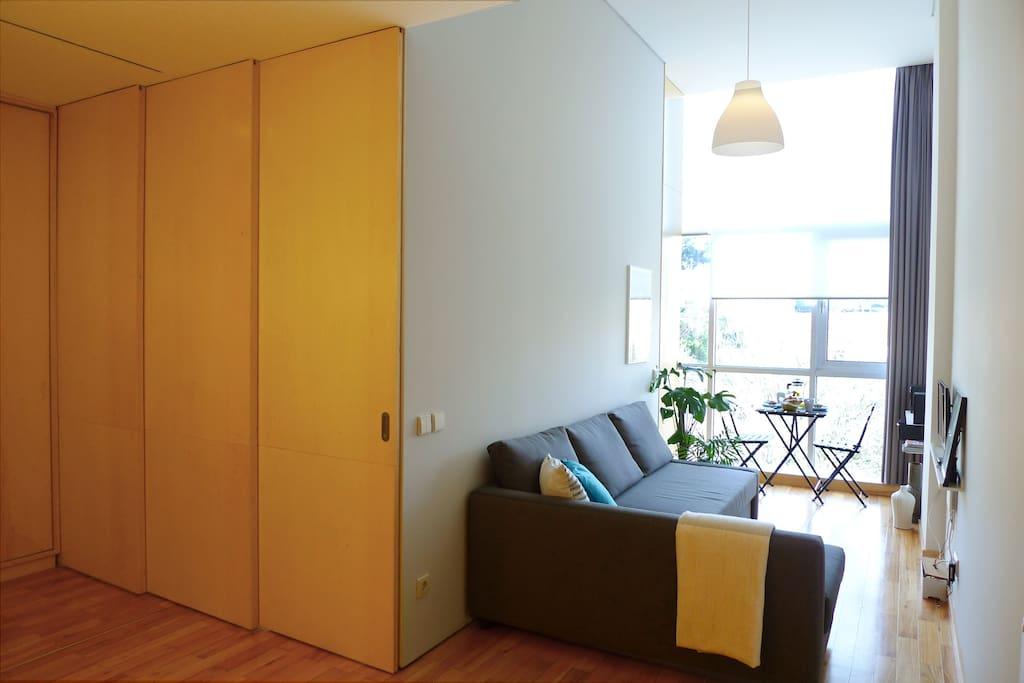 Sliding-doors separate bedroom from living-room