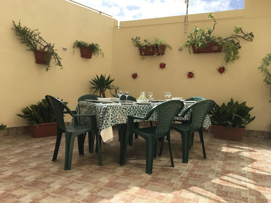 On the other side of the large outdoor area - the dining table and chairs