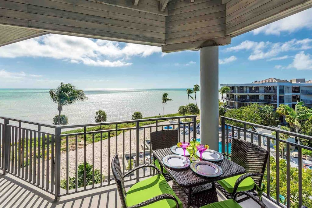 Enjoy an oceanfront meal at the dining table on the balcony...