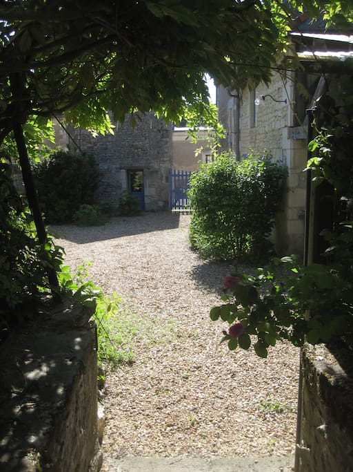 The property is made of 3 buildings with this courtyard in the centre.