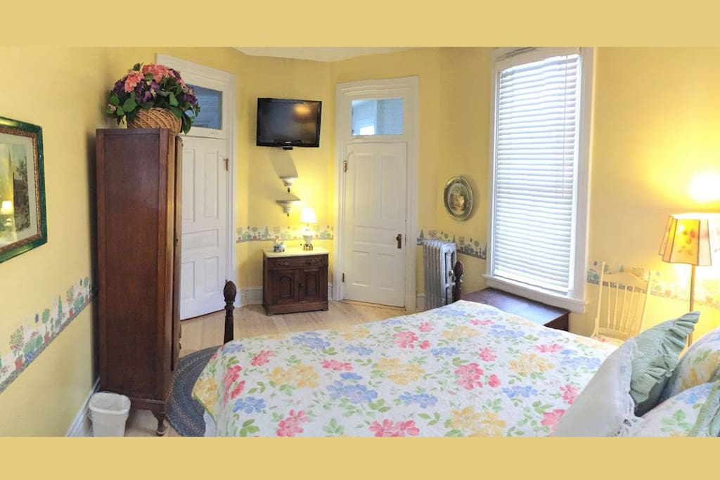 The Spring Breeze room has its own HD TV and an attached private bathroom with it's own private balcony.