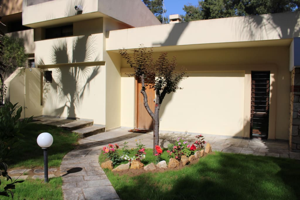 Front entrance of the house with an outside shower