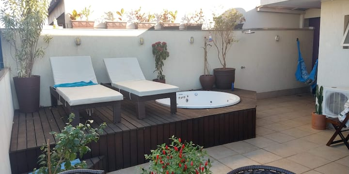 Amazing duplex apartment,  rooftop with jacuzzi