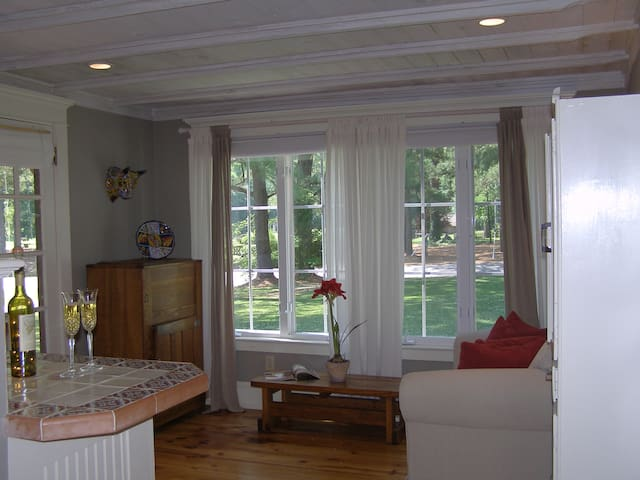 Kitchenette/den has original pine floors. The wood used for the ceiling is also original. You can enjoy the lake view or the countryside.