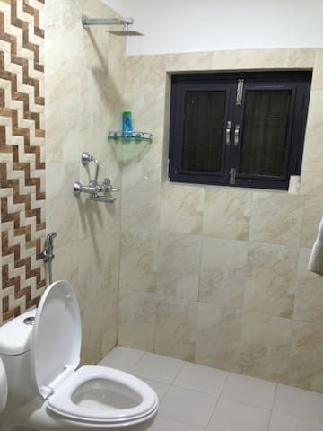 Modern ensuite bathroom with hot water