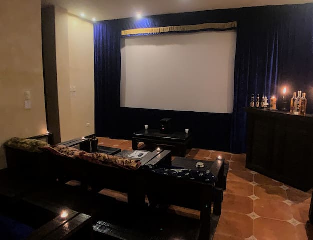 A complete theater with a 12 foot screen