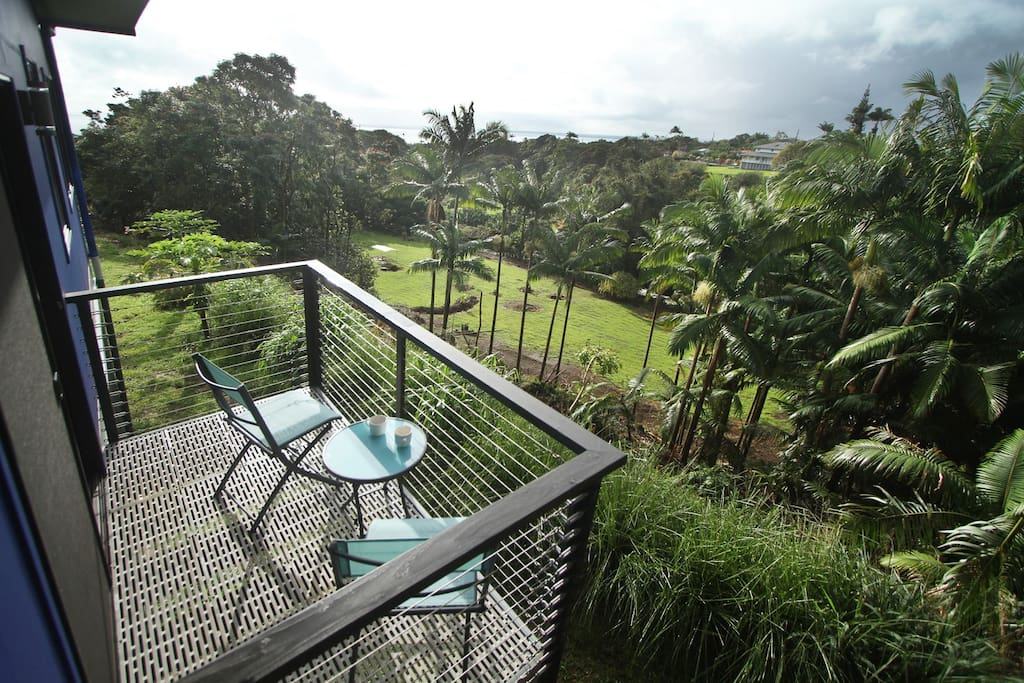 Hilo Bay bedroom's private lanai overlooking ocean, beaches river and jungle