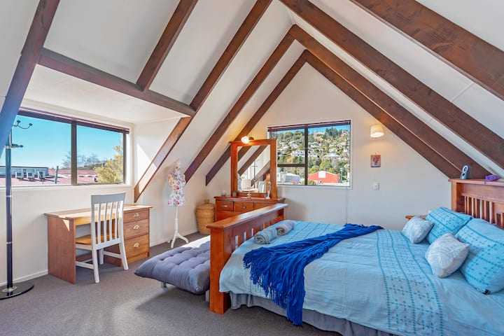 Large sunny King size bedroom in a breezy house