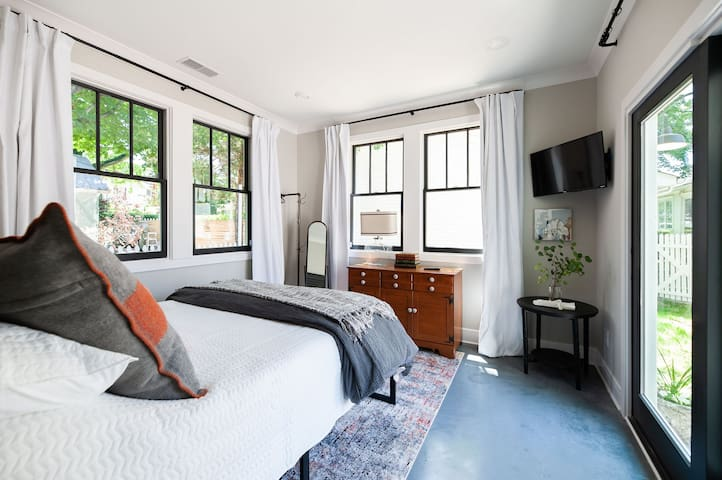 Queen bedroom in the back of the house with sliding doors out to the private patio.