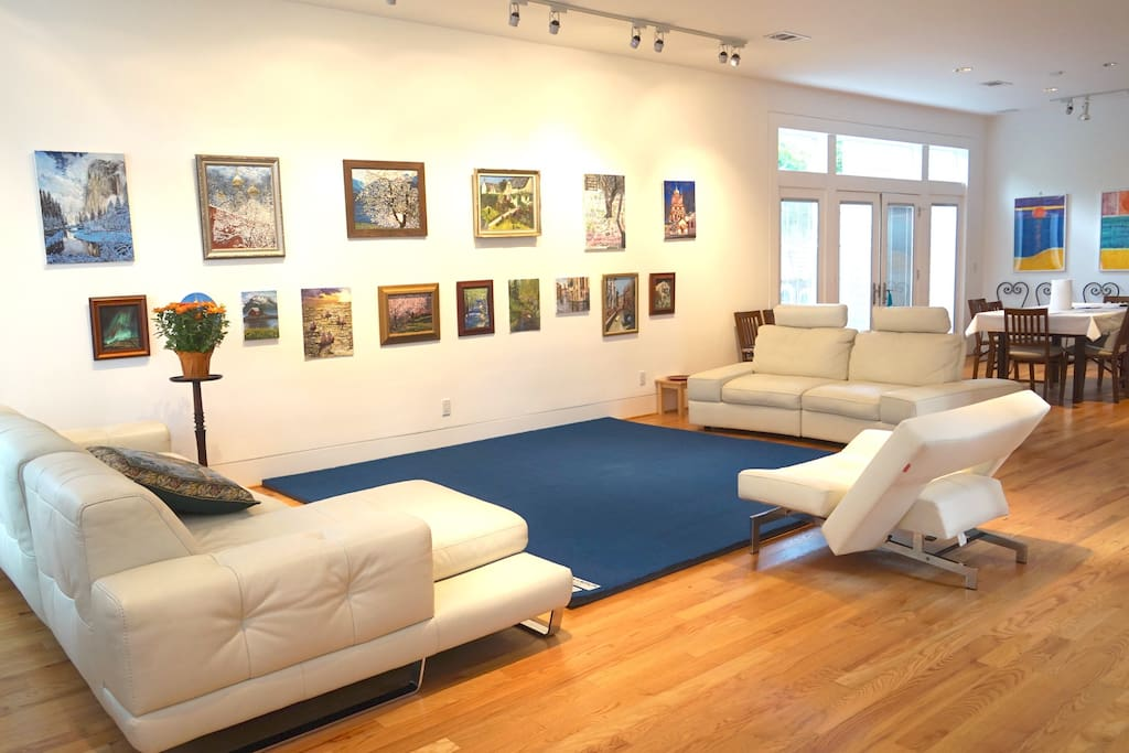 Shared living room with boutique art exhibits, 1st floor