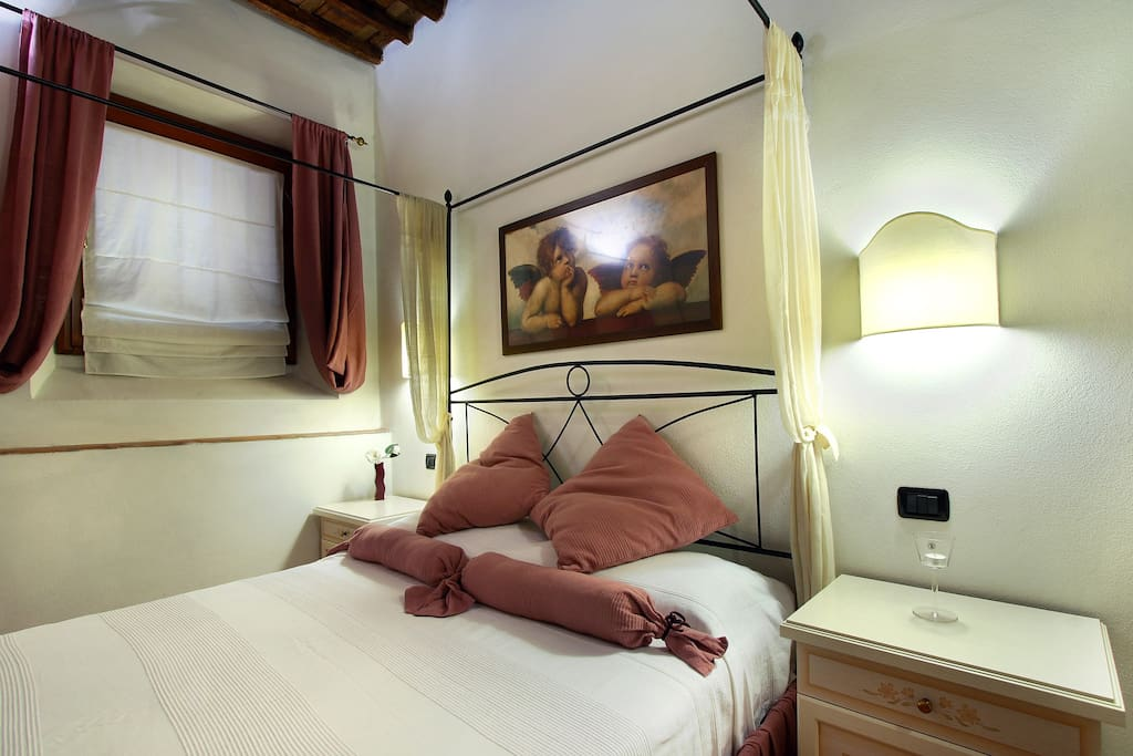 Double Bedroom with Air Conditioner, windows, Armchair, Original Tuscan wooden ceiling.