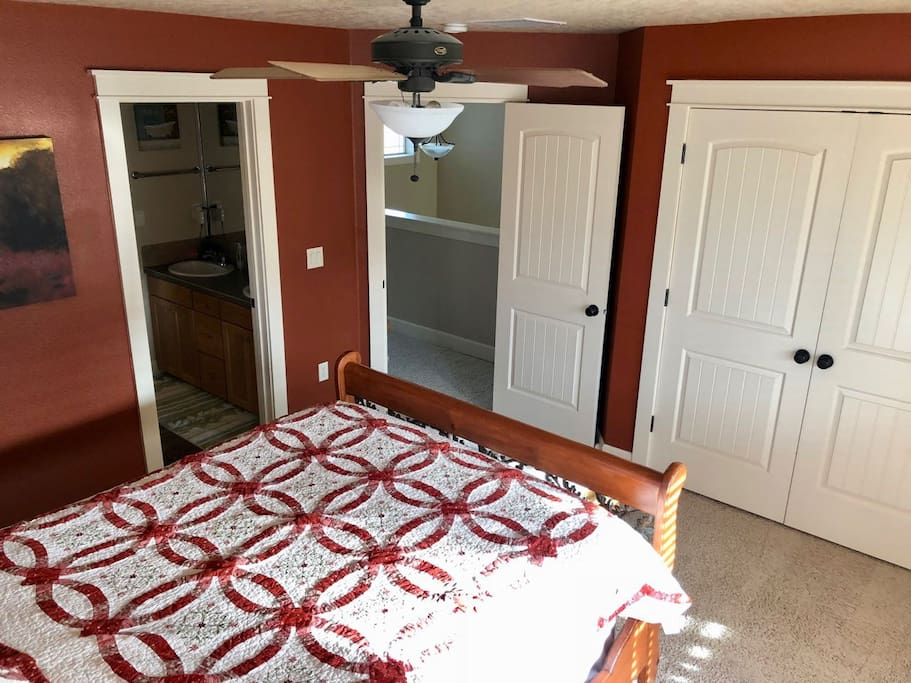 """""""Red"""" room, showing closet doors on the right (extra blankets, towels, etc), middle door to foyer balcony (mini kitchen), and door on left to Jack 'n' Jill bath"""